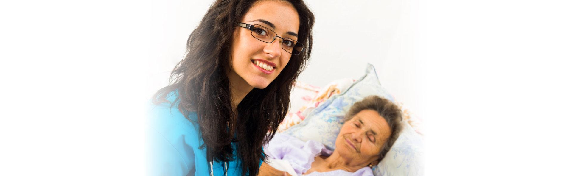 Smiling nurse caring for kind elder patient in nursing home.